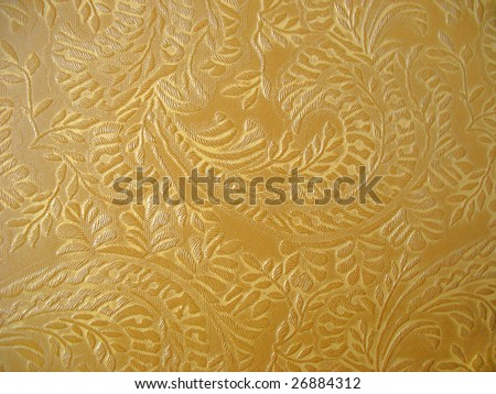 Floral upholstery golden color fabric background - stock photo