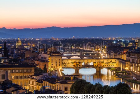 Florence, Arno River and Ponte Vecchio after sunset, Italy - stock photo