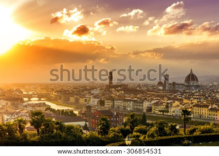 Florence at a beautiful sunset from Piazzale Michelangelo (Tuscany, Italy) - stock photo