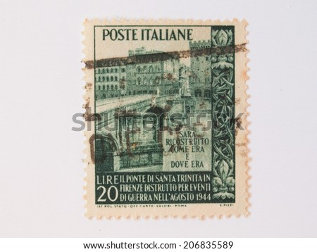 FLORENCE, CIRCA DECEMBER 2013 - Italian stamp released in 1945 bearing the image of Ponte Santa Trinita bridge in Florence just rebuilt after being bombed by the Nazi troups in 1944 - stock photo