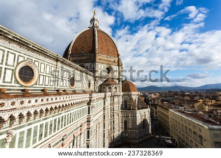 Florence, cityscape from the top of the Giotto Tower Campanile, Brunelleschi Dome in foreground - stock photo
