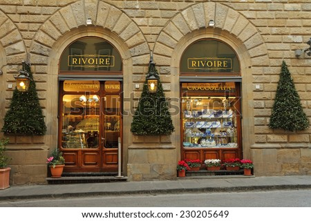 FLORENCE - DEC 5:Rivoire Cafe - founded by royal chocolatier  in 1872 -on December,5,2013.Inferno's main character said:no trip to the piazza was complete without sipping an espresso at Cafe Rivoire. - stock photo