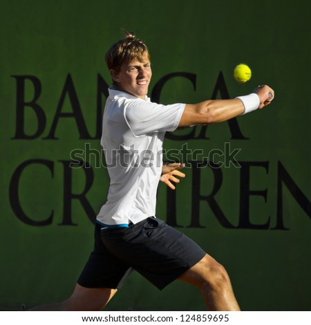 FLORENCE, ITALY - APRIL 09: Albert Alcaraz Ivorra plays a backhand at 37th City of Florence on April 09, 2012 in Florence, Italy
