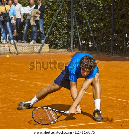 FLORENCE, ITALY - APRIL 04: Filippo Baldi plays a forehand at 37th City of Florence on April 04, 2012 in Florence, Italy - stock photo