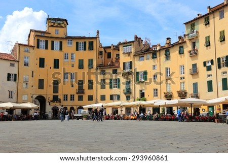 FLORENCE, ITALY - APRIL 29, 2015: People visit Old Town square (Piazza Anfiteatro or Amphitheater Square) in Lucca, Italy. Italy is visited by 47.7 million tourists a year (2013).