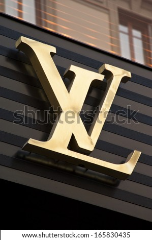 Florence, ITALY - December 8, 2011: Louis Vuitton Florence Store Logo Italy mounted on the marble wall of Louis Vuitton Store at Via de' Tornabuoni, the heart of Florence high-class shopping district