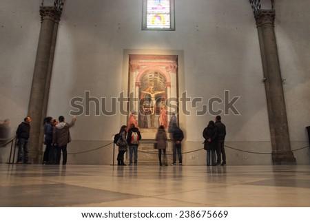 FLORENCE, ITALY - DECEMBER 7, 2014: People admire the famous Holy Trinity fresco by Masaccio 1427 in Santa Maria Novella church - stock photo