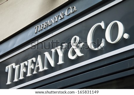 Florence, ITALY - December 8, 2011: Tiffany Florence Store Logo Italy mounted on the marble wall of Tiffany Store at Via de' Tornabuoni, the heart of Florence high-class shopping district