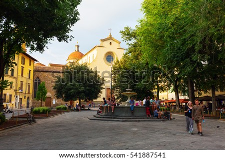 Florence, Italy - July 05, 2016: Basilica and square Santo Spirito with unidentified people. The interior of the basilica is one of the preeminent examples of Renaissance architecture.