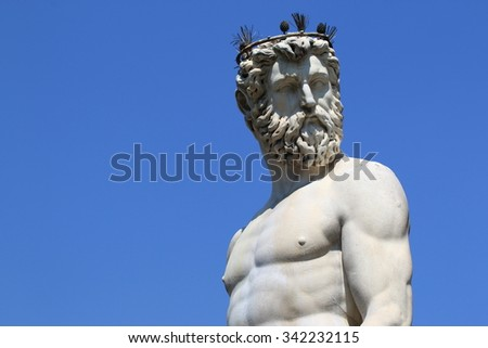 FLORENCE, ITALY - JULY 16, 2015: The Fountain of Neptune by Bartolomeo Ammannati in front of the Palazzo Vecchio at Piazza della Signoria in Florence, Italy. - stock photo
