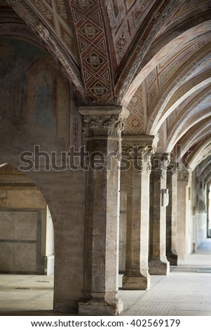 Florence, Italy-June 2, 2015. Architectural and decoration details of the cloisters of the Basilica of Santa Maria Novella, situated just across from the main railway station which shares its name.