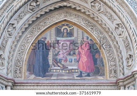 FLORENCE, ITALY - JUNE 05: Charity among the founders of Florentine philanthropic institutions, Left Portal of Cattedrale di Santa Maria del Fiore, Florence, Italy on June 05, 2015 - stock photo