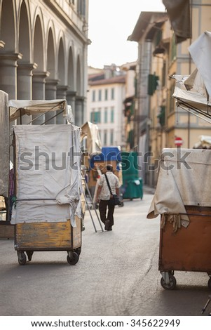 Florence, Italy-June 2, 2015. Early morning at the famous San Lorenzo outdoor leather market during the  set up of the market stalls