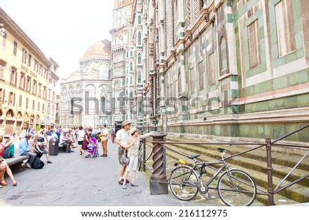 FLORENCE, ITALY - JUNE 11: Famous Florence cathedral in Florence, Italy on June 11, 2014. The basilica is one of Italy's largest churches and part of the UNESCO World Heritage Site. - stock photo
