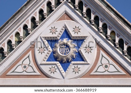 FLORENCE, ITALY - JUNE 05: IHS sign, Basilica di Santa Croce (Basilica of the Holy Cross) - famous Franciscan church in Florence, Italy, on June 05, 2015 - stock photo
