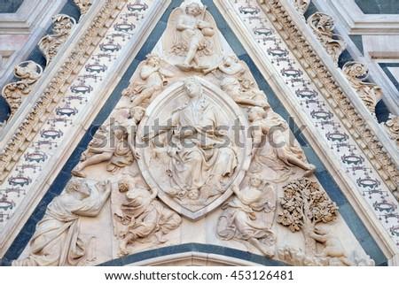 FLORENCE, ITALY - JUNE 05: Madonna of the Girdle, Portal of Cattedrale di Santa Maria del Fiore (Cathedral of Saint Mary of the Flower), Florence, Italy on June 05, 2015 - stock photo