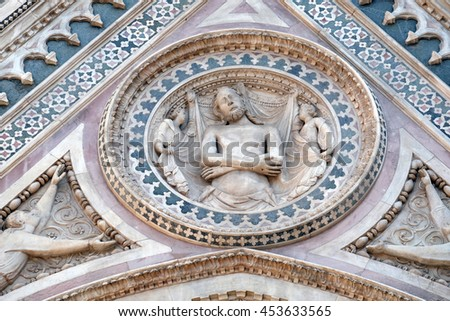 FLORENCE, ITALY - JUNE 05: Wrapping Christ in his shroud, Portal on the side-wall of Cattedrale di Santa Maria del Fiore (Cathedral of Saint Mary of the Flower), Florence, Italy on June 05, 2015 - stock photo