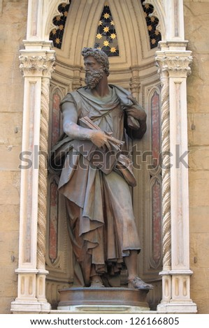 FLORENCE, ITALY - MARCH 24: Statue of Saint Lucas in the facade of Orsanmichele church on March 24, 2012 in Florence, Italy - stock photo