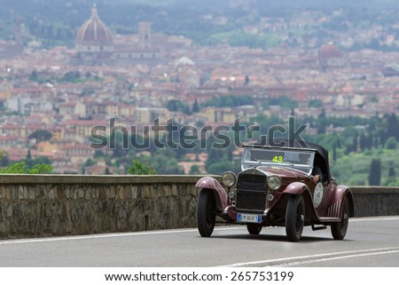 "FLORENCE, ITALY - MAY 19: Alfa Romeo 6C 1750 GT Cabriolet along Via Bolognese during the 1000 miles on May 19, 2013 in Florence, Italy . ""Mille Miglia"" is a car race attempted by many celebrities - stock photo"