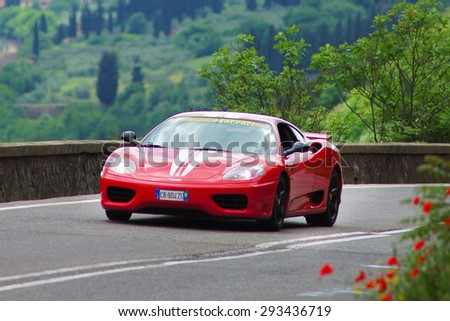 """FLORENCE, ITALY - MAY 19: Ferrari car along Via Bolognese during the 1000 miles on May 19, 2013 in Florence, Italy . """"Mille Miglia"""" is a car race attempted by many celebrities - stock photo"""