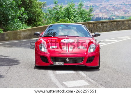 FLORENCE, ITALY - MAY 19: Ferrari 599 GTO Coupe along Via Bolognese during the 1000 miles on May 19, 2013 in Florence, Italy - stock photo