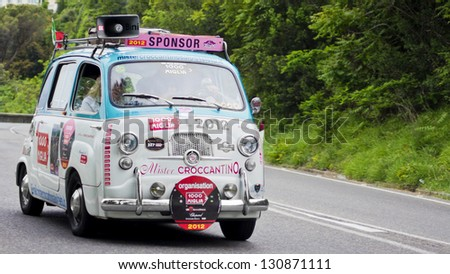 FLORENCE, ITALY - MAY 19: Fiat 600 Multipla along Via Bolognese during the 1000 Miles on May 19, 2012 in Florence, Italy. - stock photo