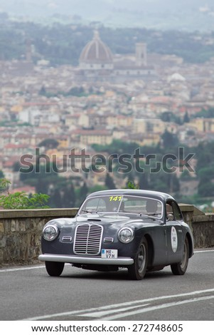 """FLORENCE, ITALY - MAY 19: Maserati A6 1500 Pininfarina along Via Bolognese during the 1000 miles on May 19, 2013 in Florence, Italy . """"Mille Miglia"""" is a car race attempted by many celebrities - stock photo"""