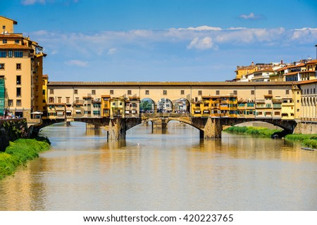 FLORENCE, ITALY - MAY 6, 2016: Ponte Vecchio (Old Bridge), a Medieval stone closed-spandrel segmental arch bridge over the Arno River, in Florence, Italy.