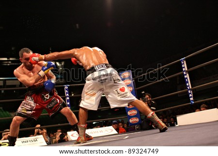 """FLORENCE, ITALY - NOV 4: """"Daniele Petrucci [Boxer-L] dodges a punch from """"Leonard Bundu"""" [Boxer-R] while fighting at """"European Welter Boxing Title"""" in Florence, Italy on Nov 4, 2011. - stock photo"""