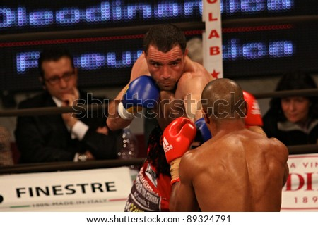 "FLORENCE, ITALY - NOV 4: ""Daniele Petrucci"" [Boxer-L] punches ""Leonard Bundu"" [Boxer-R] while figthing at ""European Welter Boxing Title"" in Florence, Italy on Nov 4, 2011."