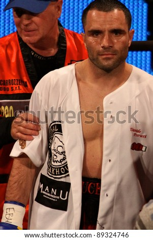 "FLORENCE, ITALY - NOV 4:  ""Daniele Petrucci"" [Boxer] with boxing robe enters the ring with his seconds at ""European Welter Boxing Title"" in Florence, Italy on Nov 4, 2011."