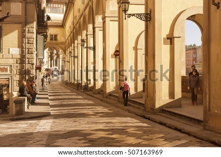 FLORENCE, ITALY - NOVEMBER 5, 2015: Lungarno degli Acciaiuoli Street in Florence city with walking tourists, Italy in antique Tone, travel outdoor background