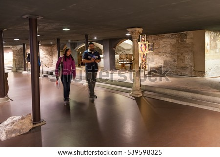 FLORENCE, ITALY - NOVEMBER 4, 2016: tourists in crypt of Duomo Cattedrale Santa Maria del Fiore (Duomo di Firenze ,Cathedral Saint Mary of the Flowers. The Cathedral is main Florence church