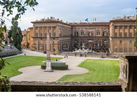 Florence, Italy - Oct 9, 2016 - View of Boboli Gardens, with the back facade of Palazzo Pitti and people who were visiting.