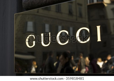 FLORENCE, ITALY - OCTOBER 31, 2015: Gucci store sign located in Via Tornabuoni, the Florence shopping street par excellence, with shops and boutiques of the most prestigious fashion brands