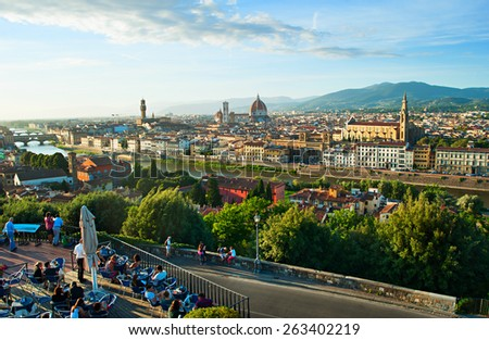 FLORENCE, ITALY - OCTOBER 9, 2013: People at a street restaurant with panoramic view to Florence at sunset. - stock photo