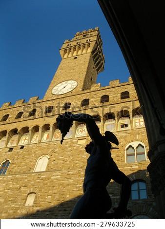 Florence, Italy. Palazzo vecchio and Benvenuto Cellini statue  - stock photo