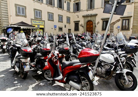 Florence, Italy - September 2014 A parking lot for delivery scooters. September 2, 2014 in Florence, Italy. - stock photo