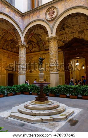 FLORENCE, ITALY - SEPTEMBER 4, 2016: Ornate courtyard in the Palazzo Vecchio. This palace is the town hall, and was built in the Middle Ages.