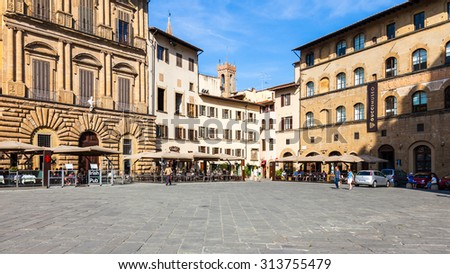 FLORENCE, ITALY - SEPTEMBER 9: Sidewalk cafes and old buildings at the popular Piazza della Signoria on September 9 2014 in Florence, Italy