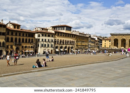 FLORENCE, ITALY - SEPTEMBER 2, 2014: Tourists in Piazza de Pitti, also known as Pitti Beach.  - stock photo
