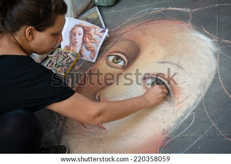 FLORENCE, ITALY - SEPTEMBER 15, 2014: unknown artist painting face of Venus (from Botticelli) on the pavement by chalk, Florence, Italy - stock photo