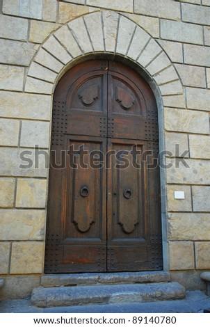 Florence, medieval building door - stock photo