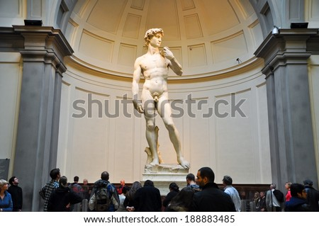 FLORENCE-NOVEMBER 10: Tourists look at David by Michelangelo on November 10,2010 in Galleria dell'Accademia in Florence. Italy. - stock photo