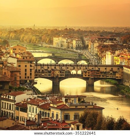Florence or Firenze sunset Ponte Vecchio bridge. Panorama view from Michelangelo park square. Tuscany, Italy - stock photo