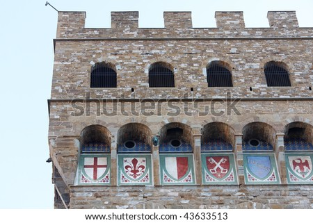 Florence Palazzo Vecchio Close up with town's main symbols - stock photo
