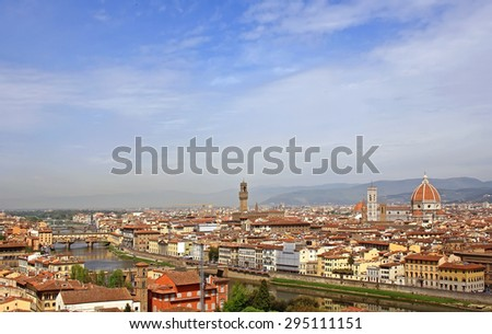 Florence panorama view with Ponte Vecchio, river Arno, Palazzo Vecchio and the Duomo cathedral - stock photo