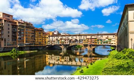 Florence, Ponte Vecchio bridge over river Arno (Tuscany, Italy) - stock photo