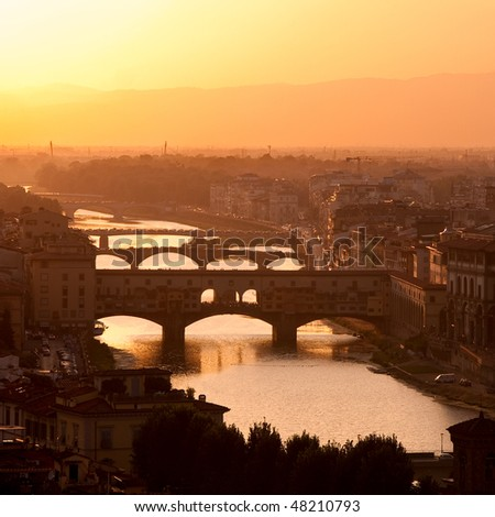Florence skyline at sunset, Italy. Ponte Vecchio sull'Arno. - stock photo
