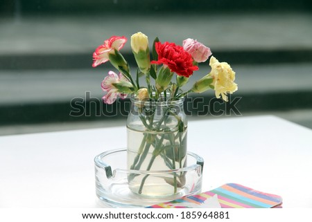 Florence Table restaurant terrace with a bunch of flowers - stock photo